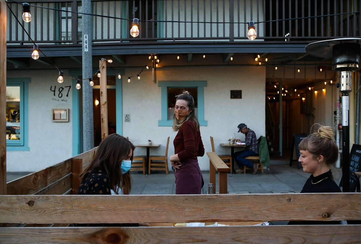 Lauren Feldman converses with dinner guests in the sidewalk parklet at Valley Bar & Bottle, a new wine shop, bar and restaurant in Sonoma.