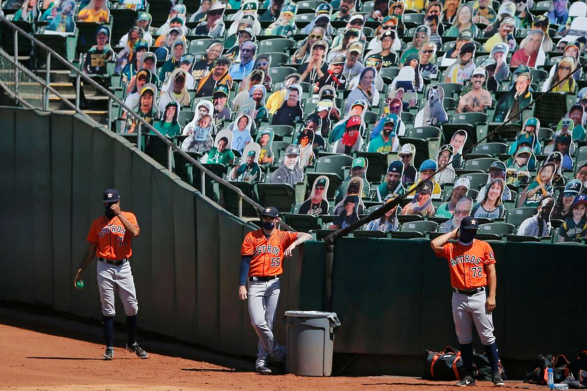 The Houston Astros' bullpen in front of fan cutouts during a game against the A's at RingCentral Coliseum on Saturday, Aug. 8, 2020.