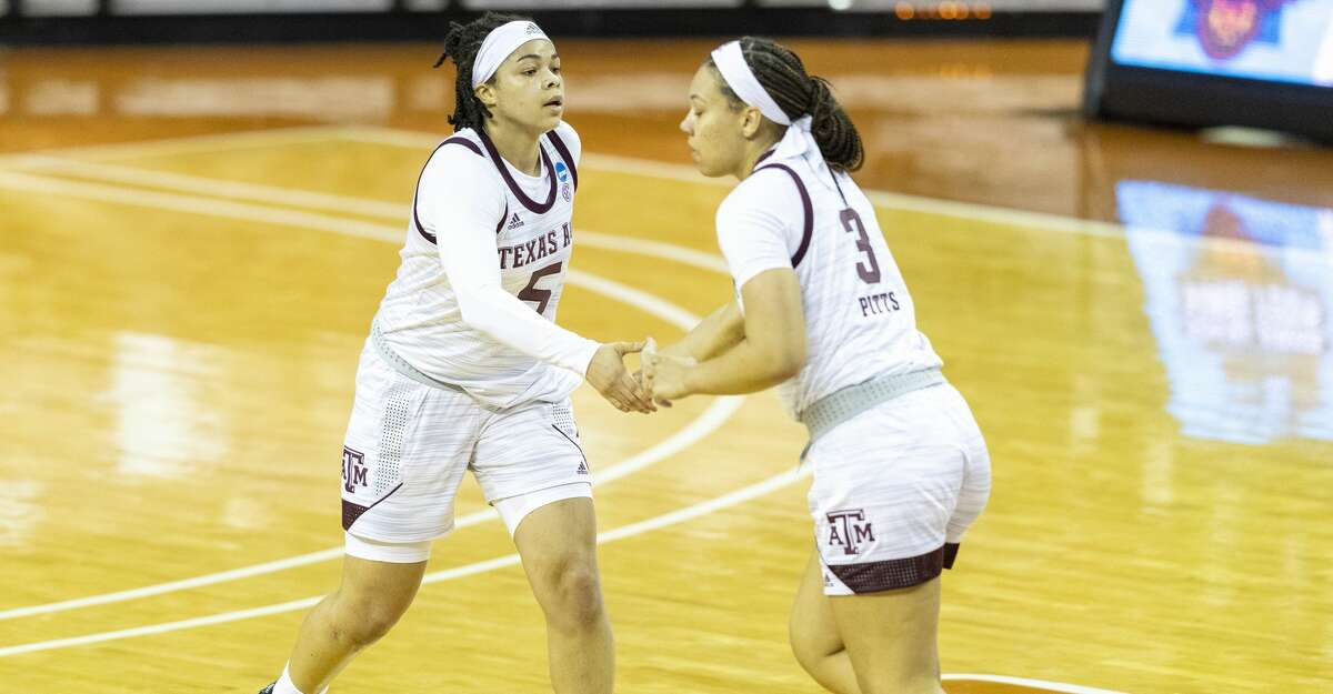 Texas A&M guard Jordan Nixon (5) and guard Destiny Pitts (3) celebrate scoring against Troy during the first half of a college basketball game in the first round of the women's NCAA tournament at the Frank Erwin Center in Austin, Texas, Monday, March 22, 2021. (AP Photo/Stephen Spillman)