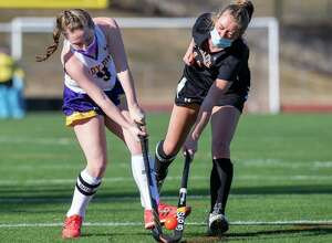 Johnstown's Emily Fleming takes a shot in front of Bethlehem's Avery Jones during a game at Knox Field in Johnstown, NY, on Monday, March 22, 2021 (Jim Franco/special to the Times Union.)