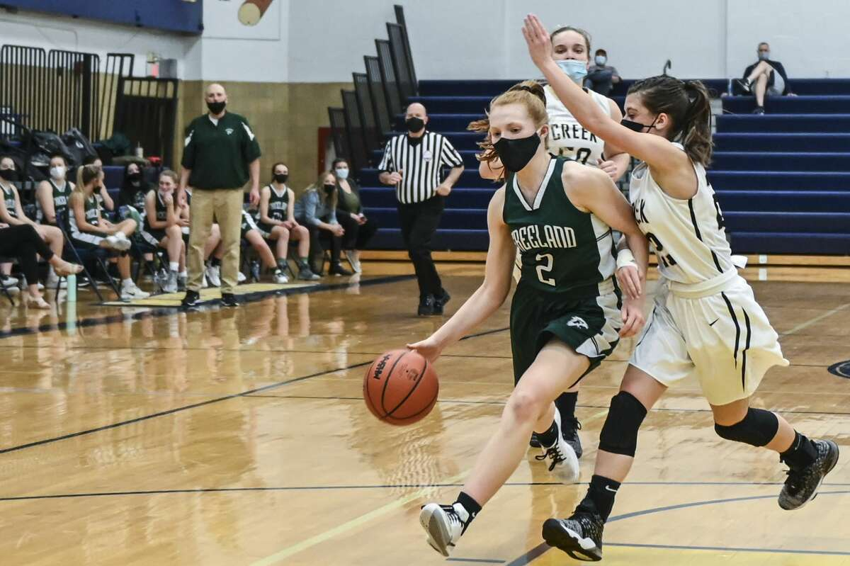 Freeland's Whitney Farrell drives to the hoop during a district quarterfinal game against Bullock Creek March 22, 2021 at Arthur Hill High School in Saginaw. (Adam Ferman/for the Daily News)