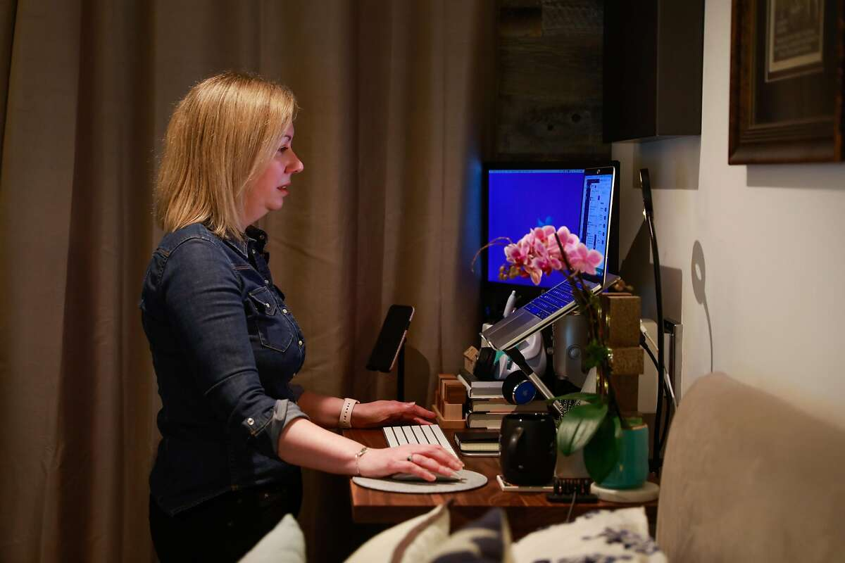 Tracy Hawkins, the Vice President of Real Estate & Workplace and Remote Experience at Twitter works remotely from her home on Thursday, March 11, 2021 in San Francisco, California.