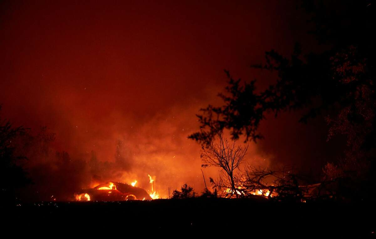 The fire burns a home along Platina Road in Igo, on September 27, 2020. - The Zogg Fire went from 400 acres to 7000 acres in a matter of hours, prompting mandatory evacuations in the region. (Photo by allison dinner and Allison Dinner / AFP) (Photo by ALLISON DINNER/AFP via Getty Images)
