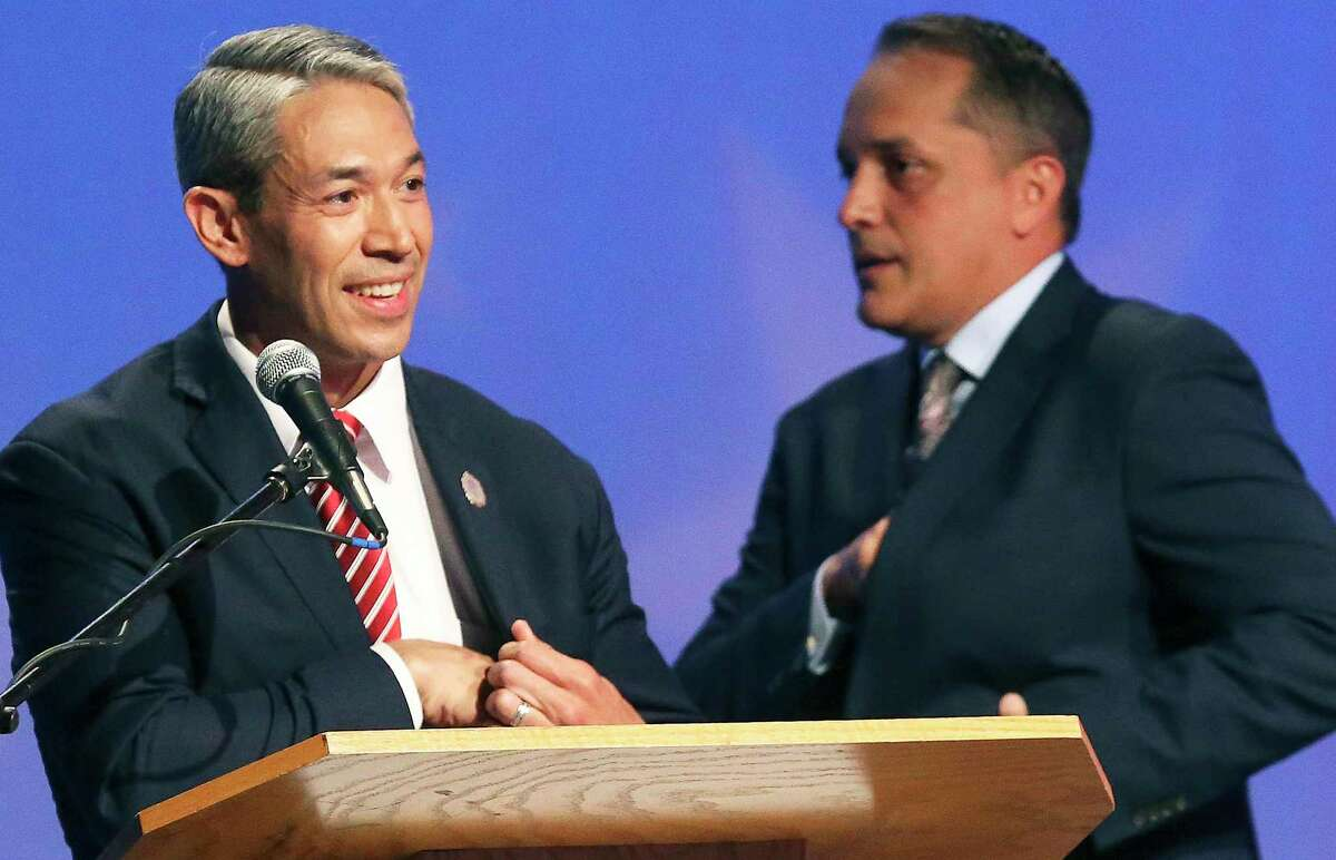 Mayoral candidates Ron Nirenberg and Greg Brockhouse avoid making eye contact after facing off May 2, 2019, in their last debate before the last city election.