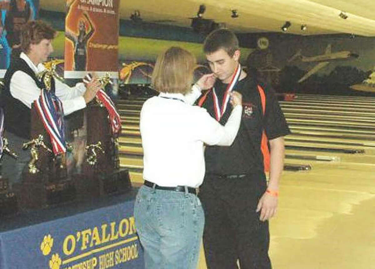 Edwardsville bowler Cody Clayton receives his first-place medal after winning the 2009 state tournament at St. Clair Bowl in Fairview Heights.