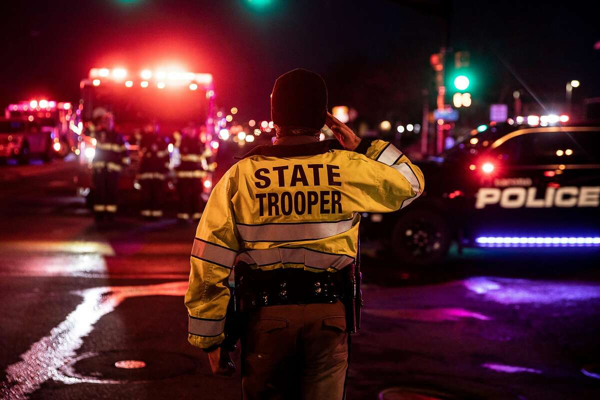 BOULDER, CO - MARCH 22: A Colorado State Police officer salutes as a procession carrying the body of a fellow officer leaves King Sooper's grocery store where a gunman opened fire on March 22, 2021 in Boulder, Colorado. Ten people, including the police officer, were killed in the attack. (Photo by Chet Strange/Getty Images) on March 22, 2021 in Boulder, Colorado. (Photo by Chet Strange/Getty Images)