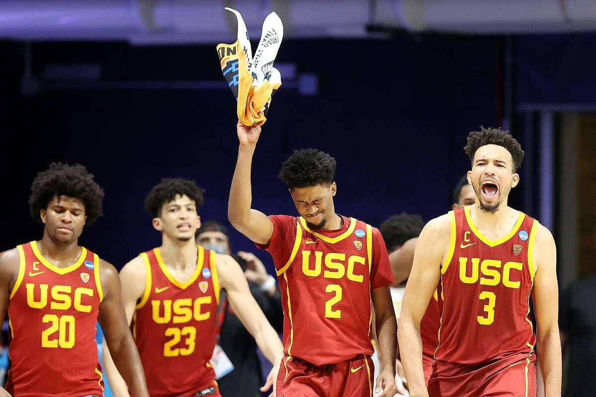 USC's Ethan Anderson (20), Max Agbonkpolo (23), Tahj Eaddy (2) and Isaiah Mobley are enthused as the Trojans rolled over Kansas by 34 points to reach the Sweet 16.