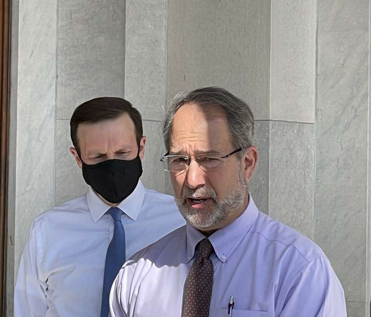 Chris George, executive director of New Haven-based Integrated Refugee & Immigrant Services, known as IRIS, has told the federal government his agency an help with the crisis of child migrants at the U.S. borders. He is shown with Sen. Chris Murphy at the state Capitol on Monday, March 22, 2021.