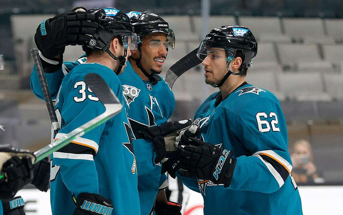 Sharks teammates congratulate Logan Couture (left) after he scored a goal in the first period of San Jose's 2-1 win over Los Angeles at SAP Center.