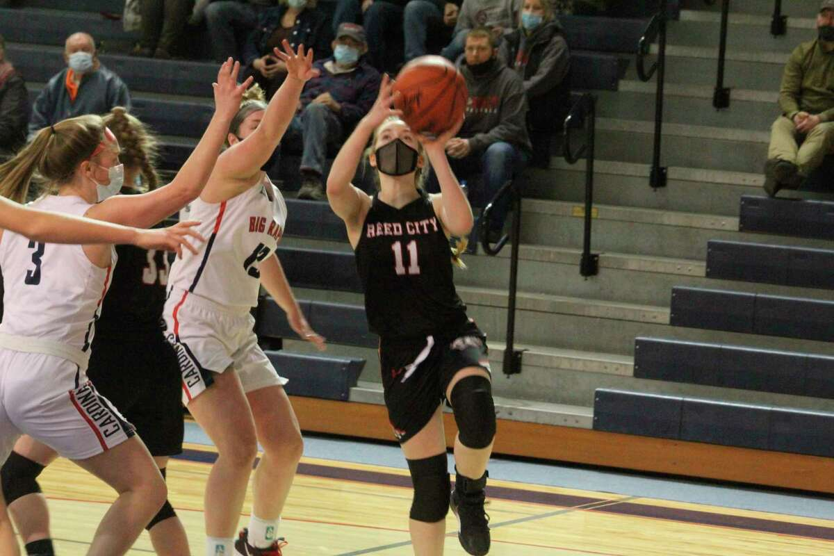 Reed City girls basketball junior Paige Lofquist (11) goes to the basket during action this season. (Pioneer file photo)