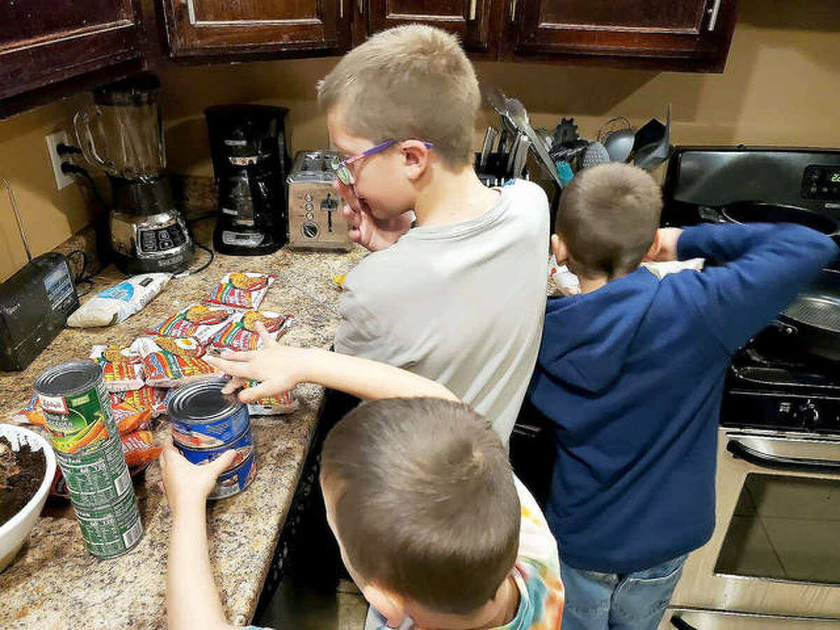 """The children of Metro East Community Rotary Club member Abby Schwent tested one of the recipes for """"Asian Night,"""" which is among the meal packets the club helps provide to patrons at Glen Ed Pantry."""