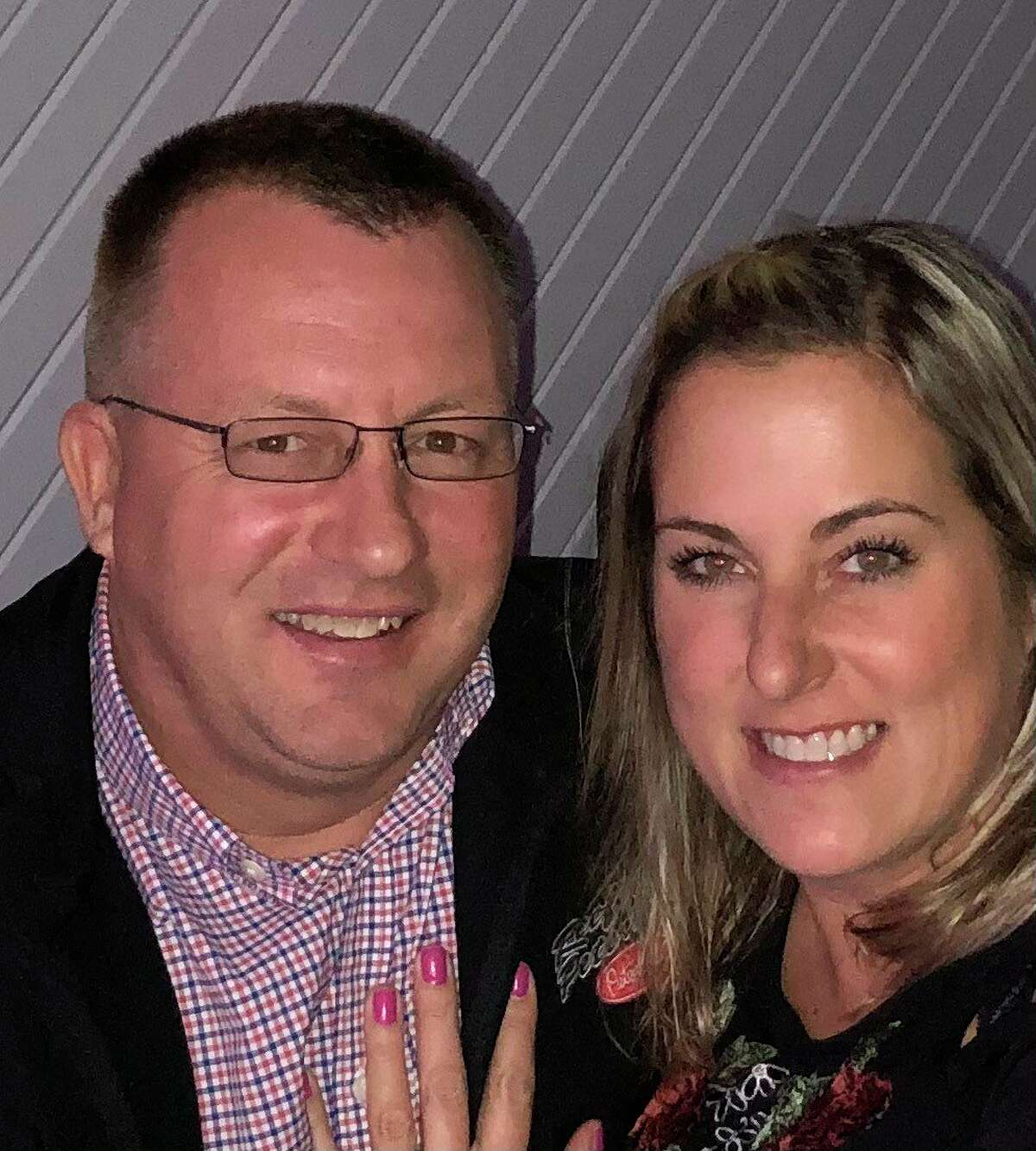 Melissa Mell with her fiancé Jerald Ignash. The two own two One-Stop Shop locations and Cottage Inn Pizza and are finishing up renovation work with the Bay Port Inn. (Courtesy Photo/Melissa Mell)