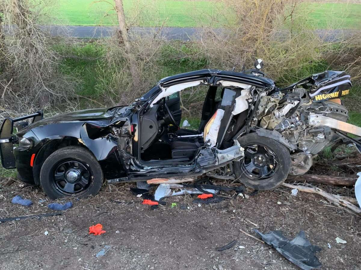 Photos of a damaged CHP vehicle at the scene of a crash that left three people dead and two CHP officers seriously injured Tuesday morning.