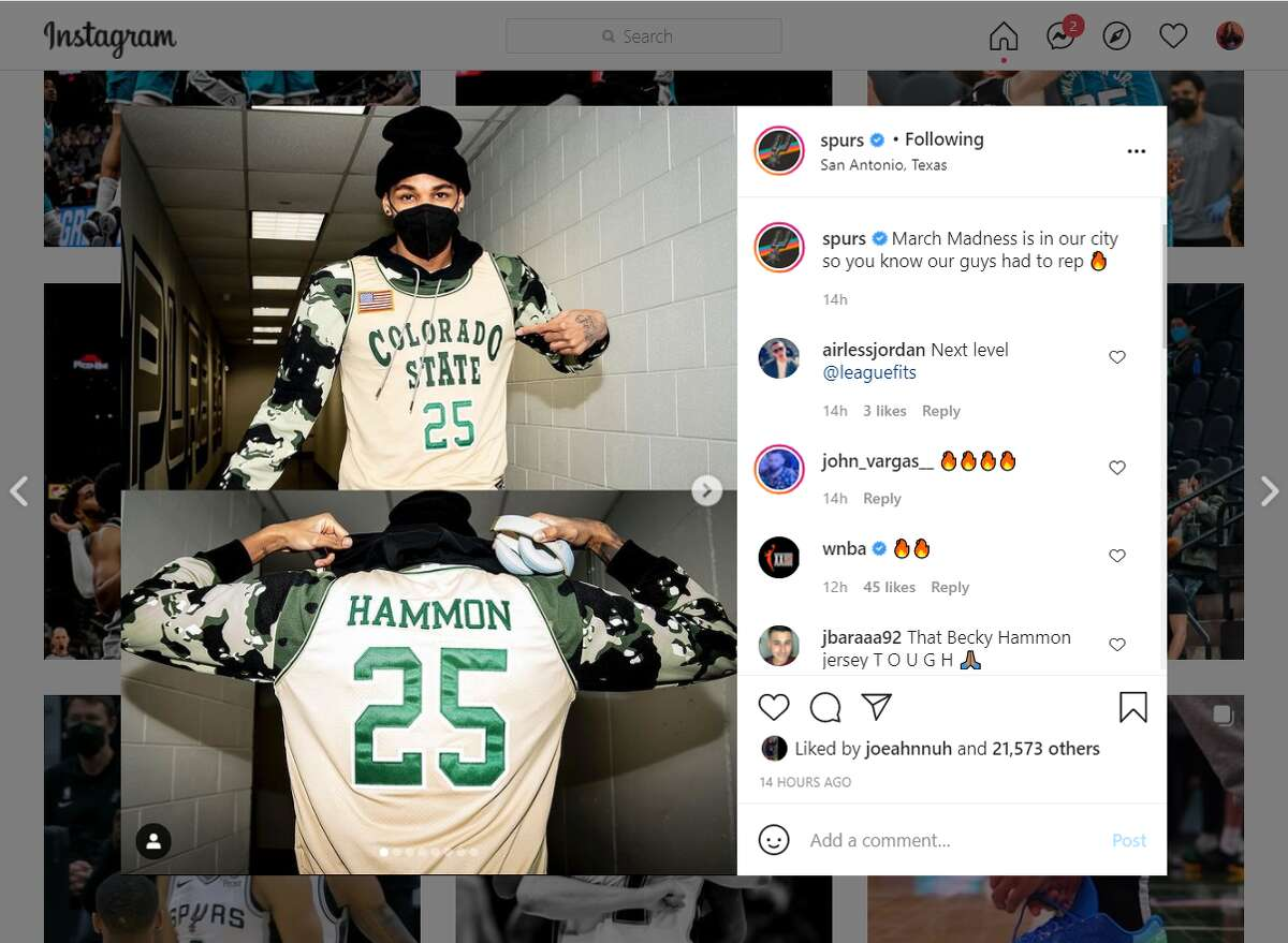 Dejounte Murray wearing Spurs assistant coach Becky Hammon's Colorado State jersey.
