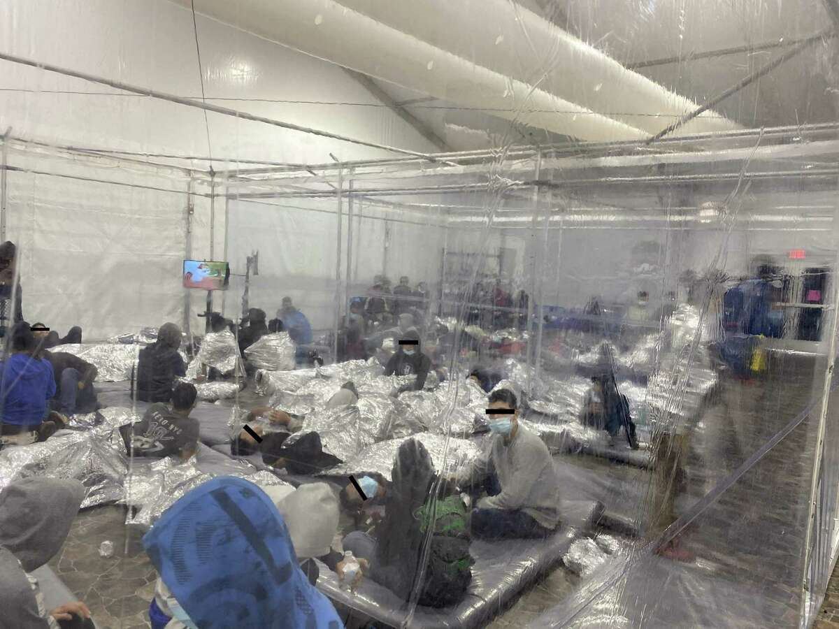 A handout photograph courtesy of the Office of Congressman Henry Cuellar, released on Monday, March 22, 2021, shows migrants inside of a US Customs and Border Protection temporary overflow facility in Donna, Texas.