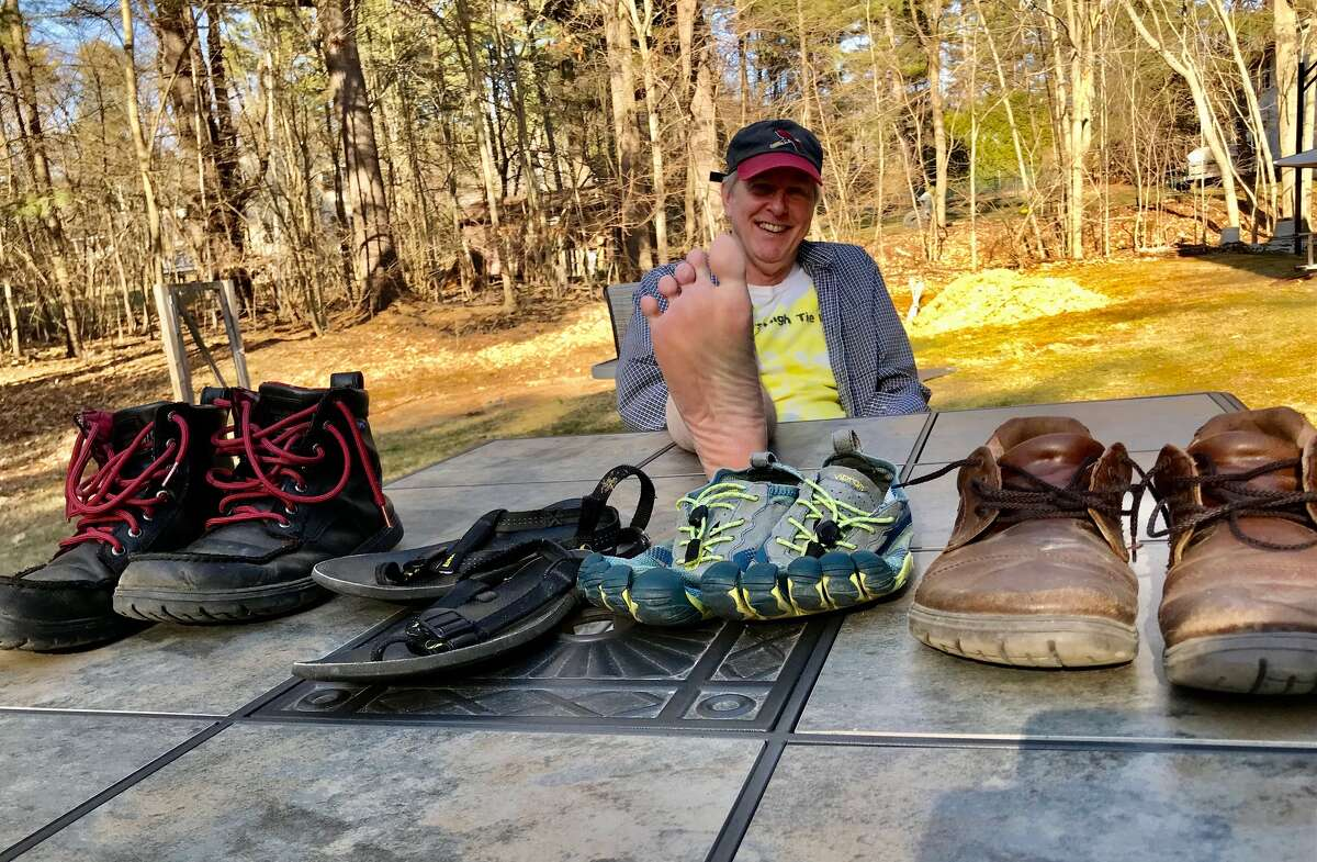 Rik Scarce displays his minimalist running and hiking shoes after spending seven years traveling widely to research the barefoot running shoe debate among podiatrists, scientists and competitive runners.
