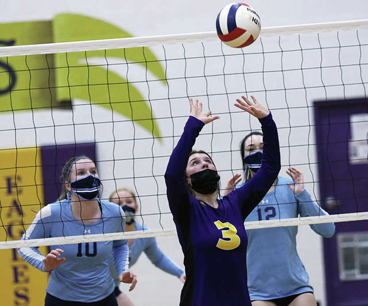 CM junior Maddie Brueckner (3) sets while Jersey's Caroline Gibson (10) and Danielle Long (12) prepare for a block at the net in a MVC match last week in Bethalto. On Monday, night Brueckner's Eagles moved to 3-0 with a two-set victory over Alton in Bethalto.