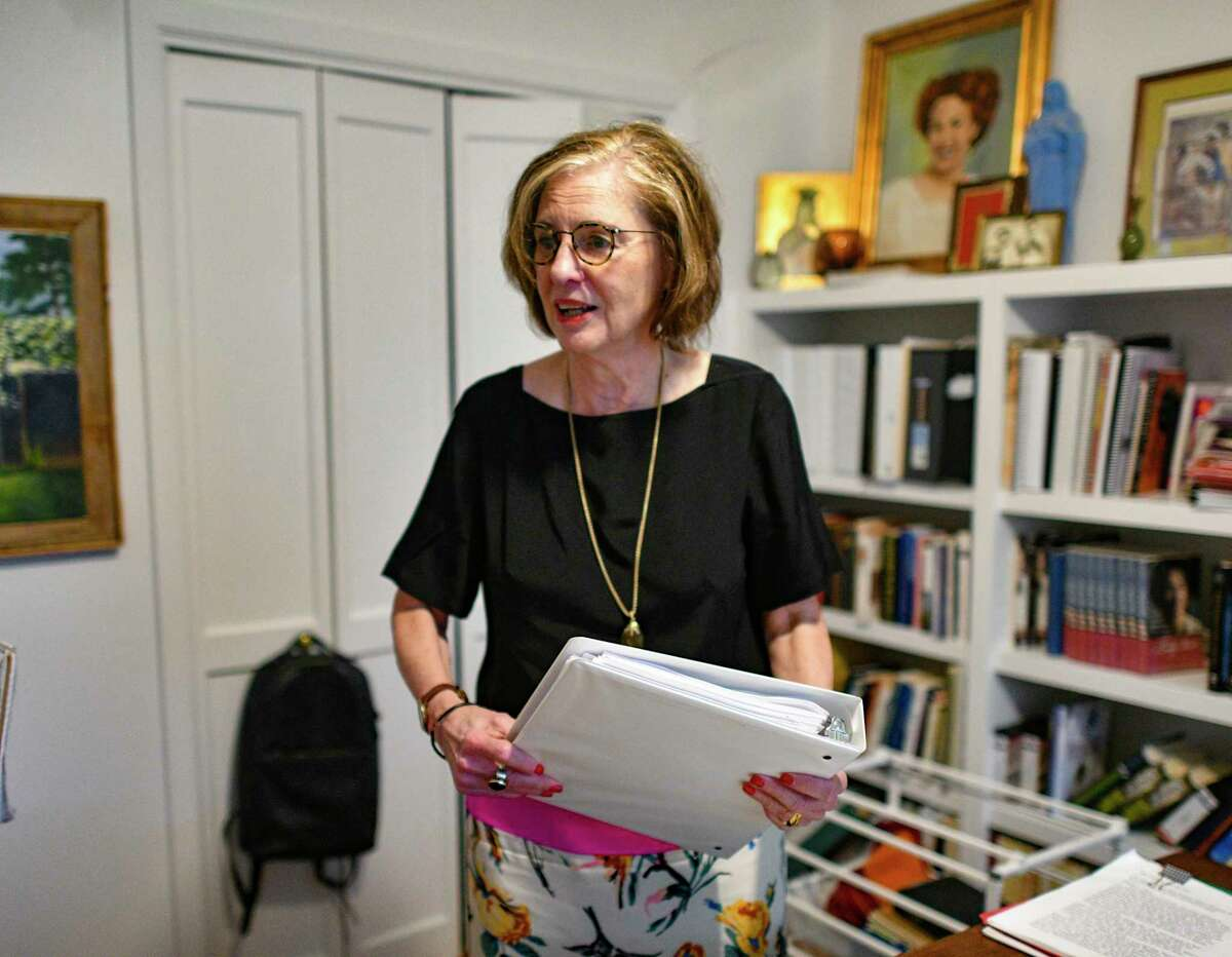"""Author Jan Jarboe Russell shows some of the files she keeps in binders for the writing projects she has worked on in her office. Her new book is """"Eleanor in the Village: Eleanor Roosevelt's Search for Freedom and Identity in New York's Greenwich Village."""""""
