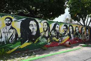 A mural of Ethiopian Emperor Haile Selassie I, Jamaican reggae legend Bob Marley and his seven sons stands on the grounds of the Bob Marley Museum in Kingston, Jamaica. State legislators, airport officials and others in Connecticut and Jamaica are seeking to establish nonstop flights between Bradley International Airport in Windsor Locks, Conn., and Jamaica.