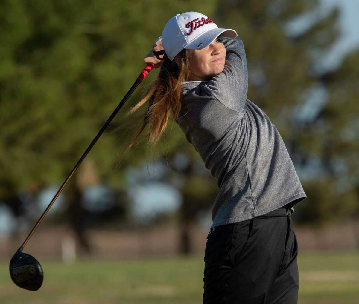 Lee High's Gracie O'Brien follows her shot 03/23/21 at Ranchland Hills Golf Club during the second day of play in the District2-6A golf tournament. Tim Fischer/Reporter-Telegram