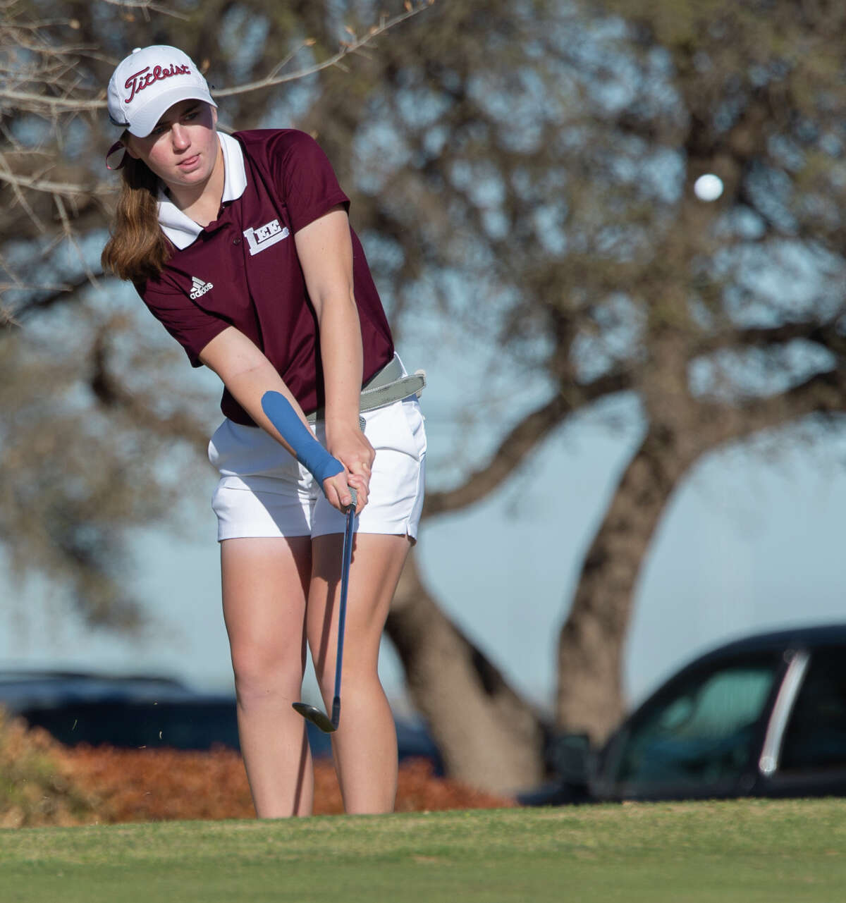 Lee High's Sarah Reed chips onto the green 03/23/21 at Ranchland Hills Golf Club during the second day of play in the District2-6A golf tournament. Tim Fischer/Reporter-Telegram