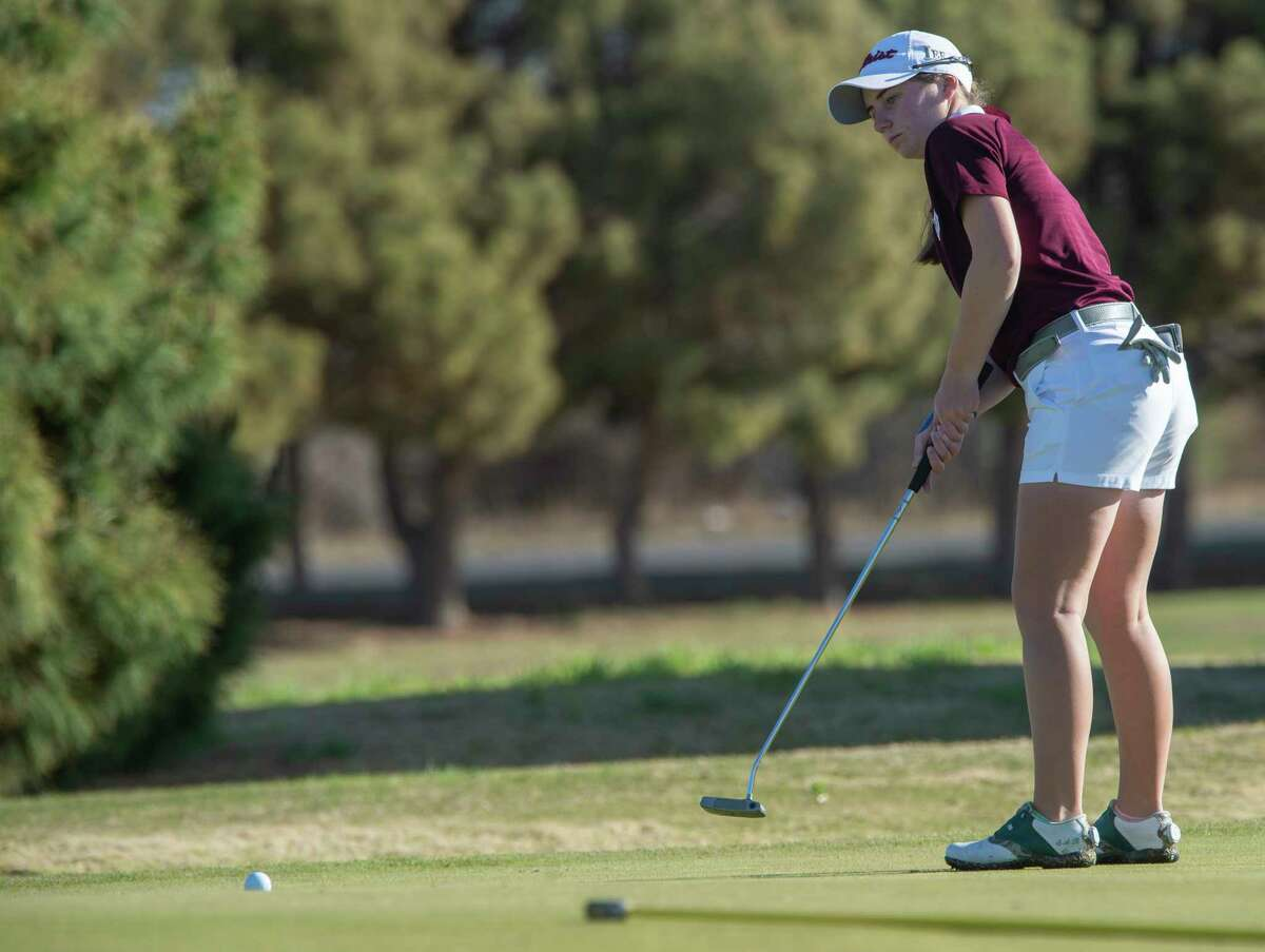 Lee High's Sarah Reed follows her putt 03/23/21 at Ranchland Hills Golf Club during the second day of play in the District2-6A golf tournament. Tim Fischer/Reporter-Telegram