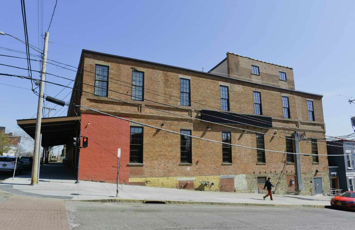 A former electrical warehouse and Nabisco bakery at North Pearl Street and Livingston Avenue in Albany is the new, $14 million home of Capital Repertory Theatre. The Livingston Avenue sidewalk will be heated to keep it clear of snow and ice. A sign for The Rep will be painted to the left of the first-floor windows. An electronic marquee sits between the two floors' windows. Photographed Tuesday, March 23, 2021, in Albany, N.Y. (Paul Buckowski/Times Union)