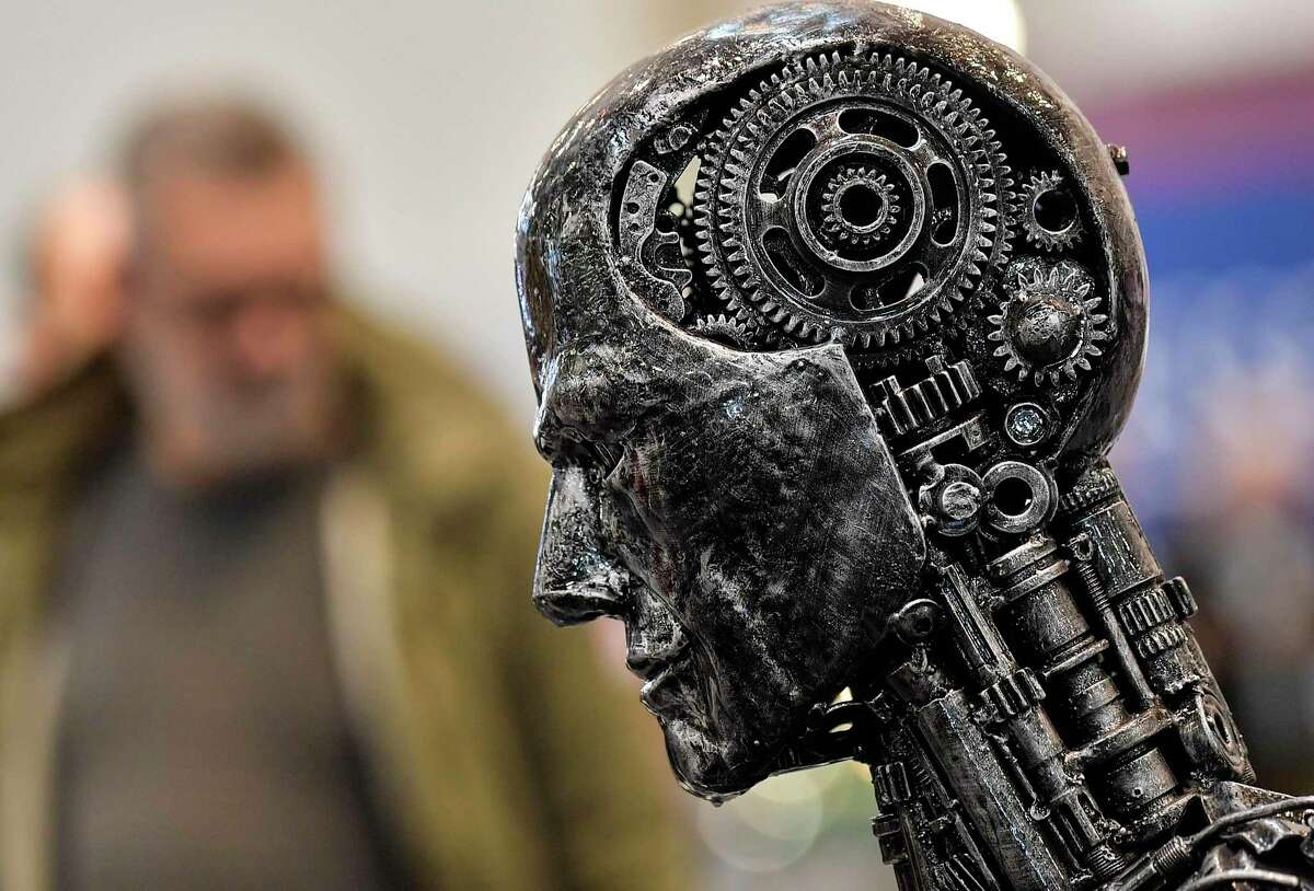 A metal head made of motor parts symbolizes artificial intelligence, or AI, at the Essen Motor Show for tuning and motorsports in Essen, Germany.