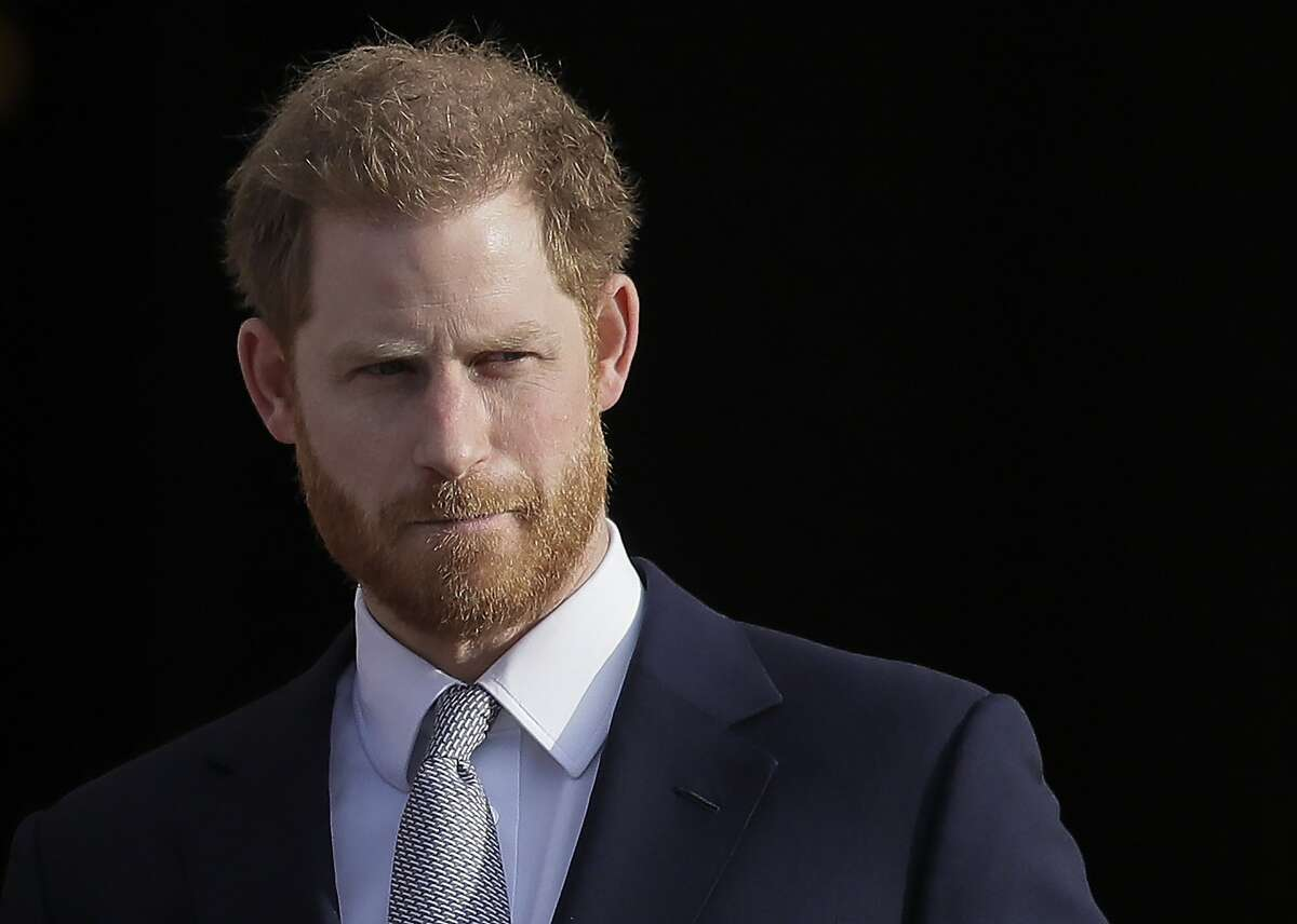 In this Jan. 16, 2020, file photo, Britain's Prince Harry arrives in the gardens of Buckingham Palace in London. Prince Harry has joined the corporate world as employee coaching and mental health firm BetterUp Inc.'s Chief Impact Officer. Financial terms of his employment were undisclosed. BetterUp, based in San Francisco, works with employees from companies including Mars, AB InBev and LinkedIn on coaching and mental health services.
