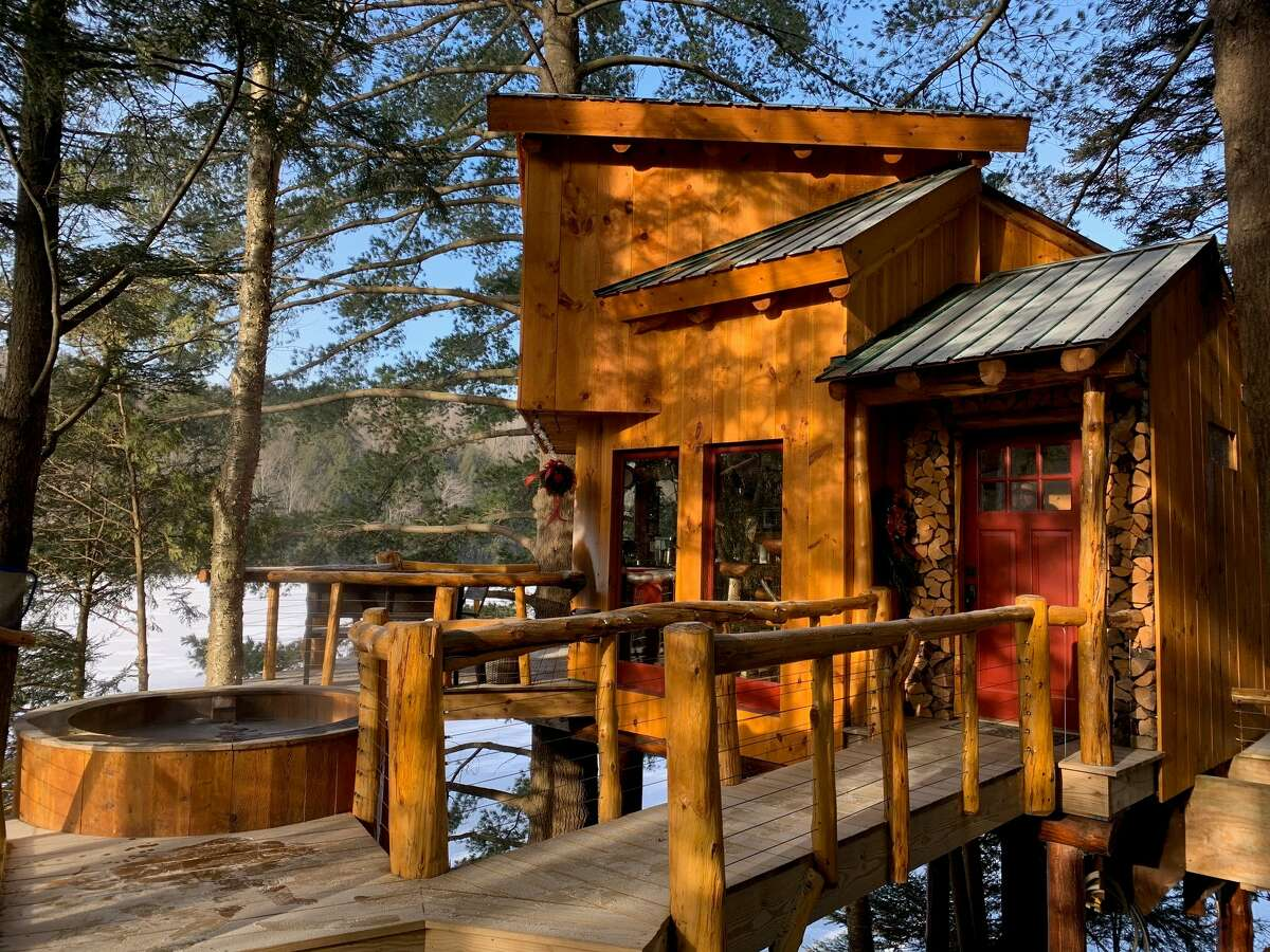 The Vermont Tree Cabin on Walker Pond, owned by Andrew & Marilou Kozak, is a popular Airbnb rental and boasts a hot tub and waffle-making amenities.