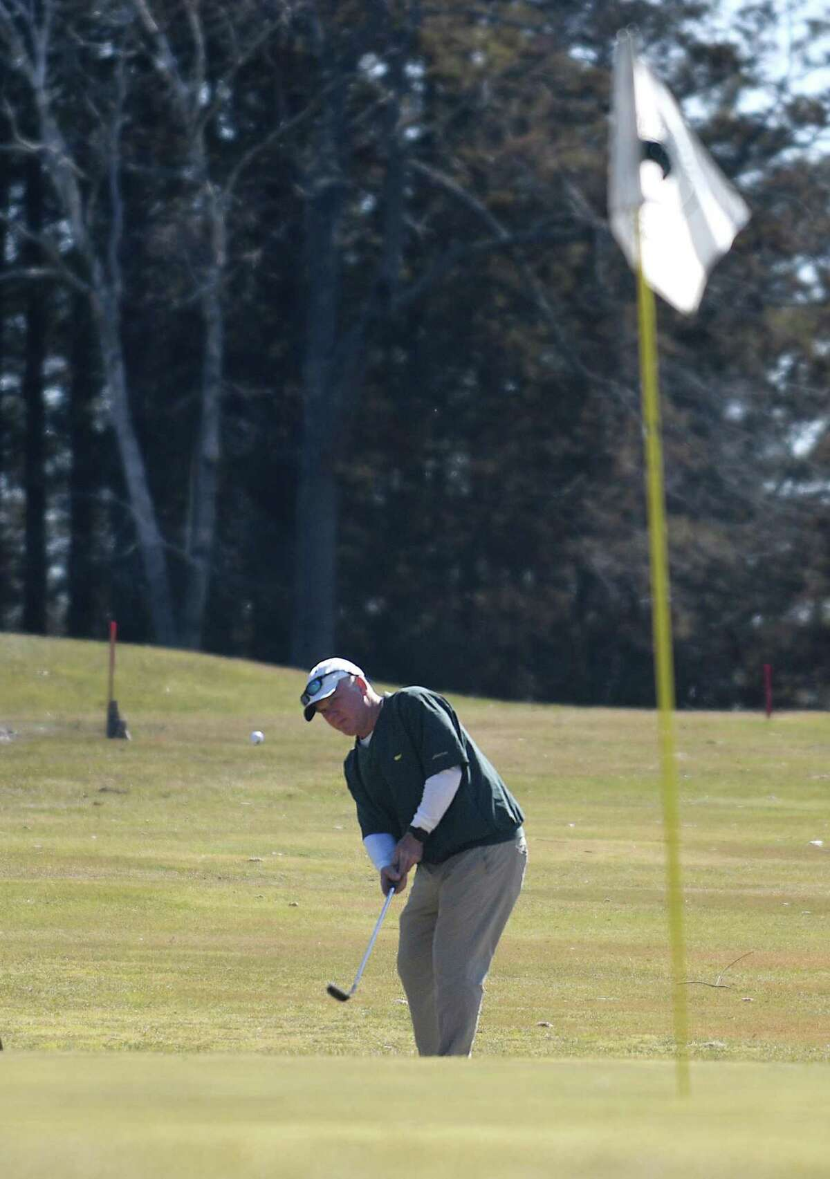 Glenville's Mark Grund chips on to the green on the opening day at Griffith E. Harris Golf Course in Greenwich, Conn. Tuesday, March 23, 2021. Greenwich's public golf course opened for the season on Tuesday.
