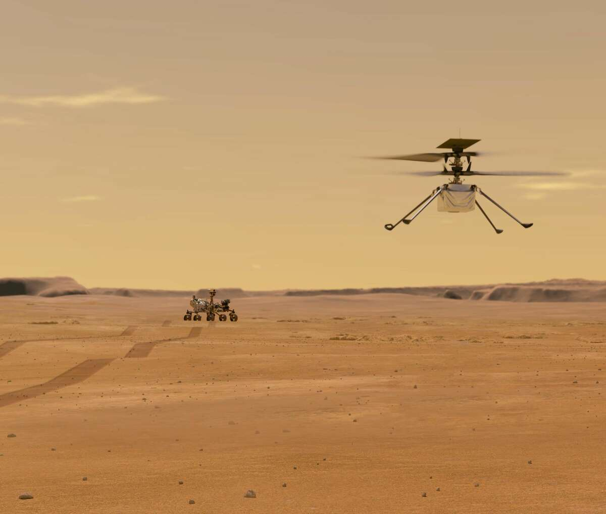 This artist illustration depicts Mars Helicopter Ingenuity during a test flight on the Red Planet. Ingenuity reached the planet on Feb. 18, 2021, strapped to the belly of the Perseverance rover (seen in the background). The helicopter's first flight could be in April.