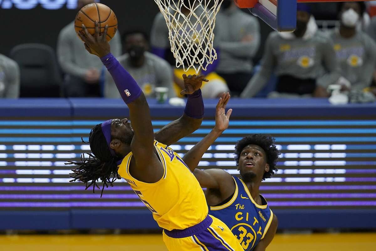 Los Angeles Lakers center Montrezl Harrell, left, shoots against Golden State Warriors center James Wiseman during the first half of an NBA basketball game in San Francisco, Monday, March 15, 2021. (AP Photo/Jeff Chiu)