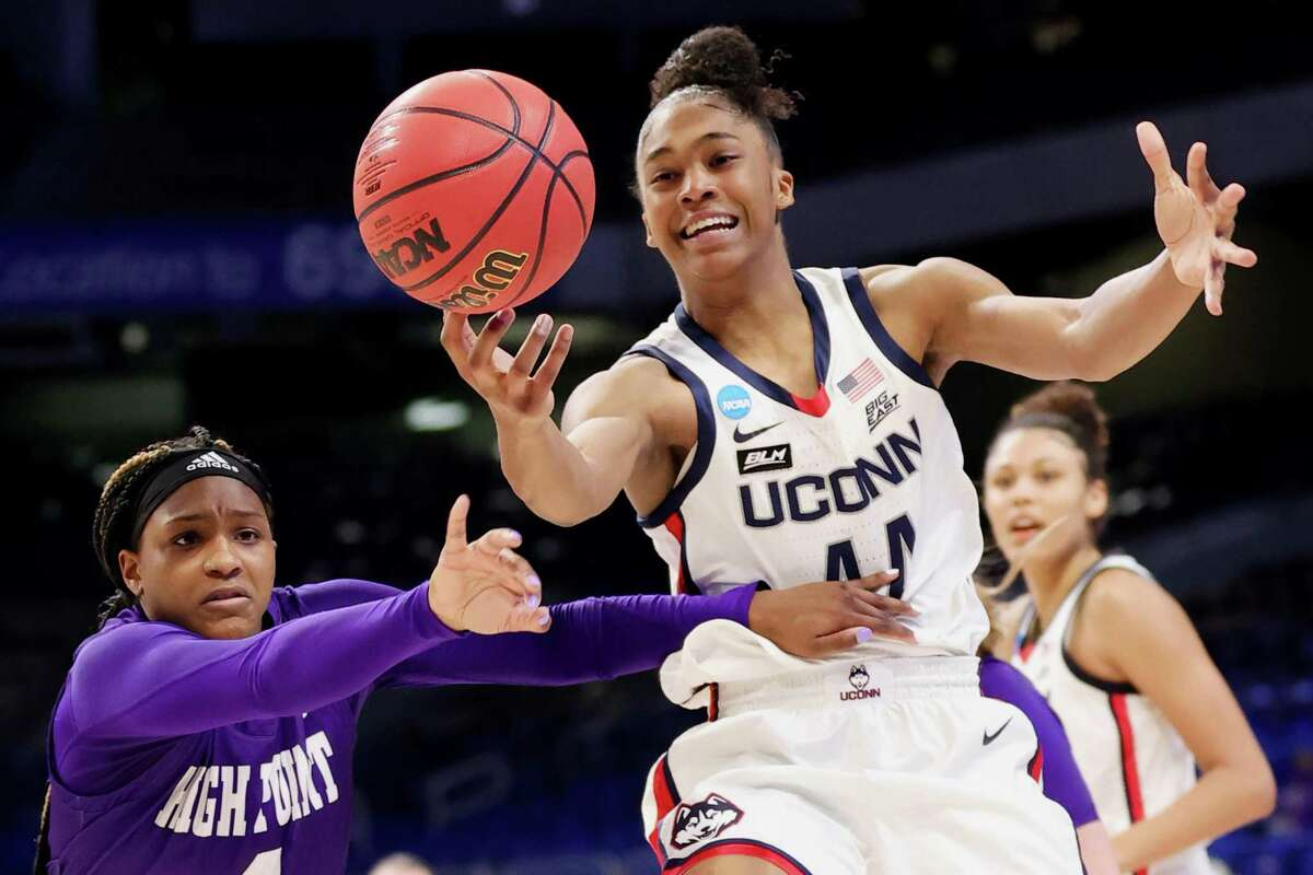 UConn's Aubrey Griffin reaches for a loose ball against High Point's Cydney Johnson during Sunday's NCAA Tournament game.