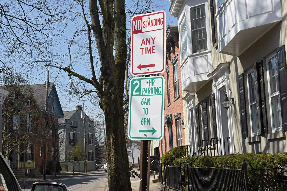 Parking signs are posted along a street in the Stockade neighborhood on Tuesday, March 23, 2021 in Schenectady N.Y. (Lori Van Buren/Times Union)