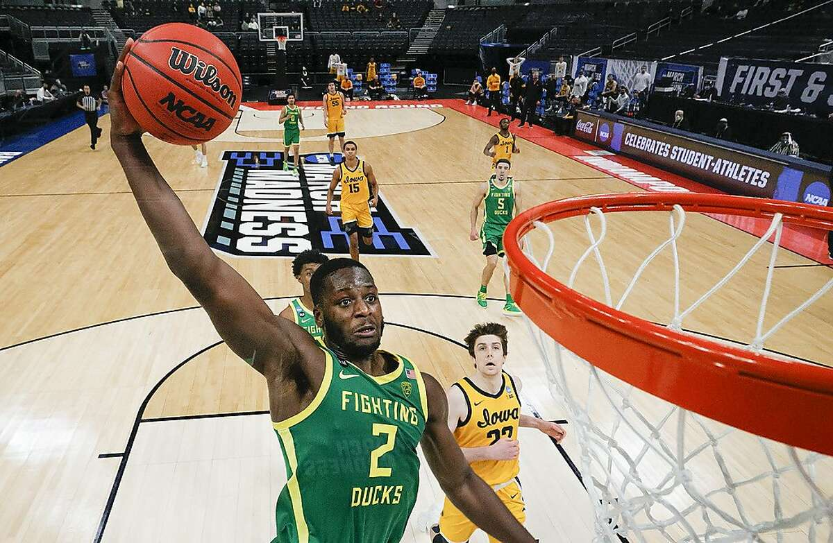 INDIANAPOLIS, INDIANA - MARCH 22: Eugene Omoruyi #2 of the Oregon Ducks drives to the basket against the Iowa Hawkeyes in the second round game of the 2021 NCAA Men's Basketball Tournament at Bankers Life Fieldhouse on March 22, 2021 in Indianapolis, Indiana. (Photo by Sarah Stier/Getty Images)