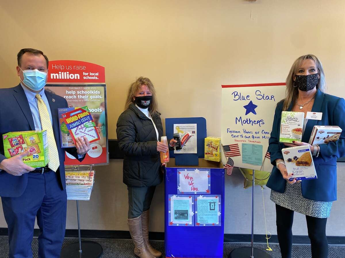 Craig A. Hayner, from left, Saratoga County clerk, Denise Romeo, executive vice president of the Saratoga County Chamber, and Kimberly Hanson, store manager of the Hannaford place items in a Yellow Ribbon Day collection box at the Clifton Park Hannaford. The items will go in care packages for troops. promoting the donation drive that benefits our troops.