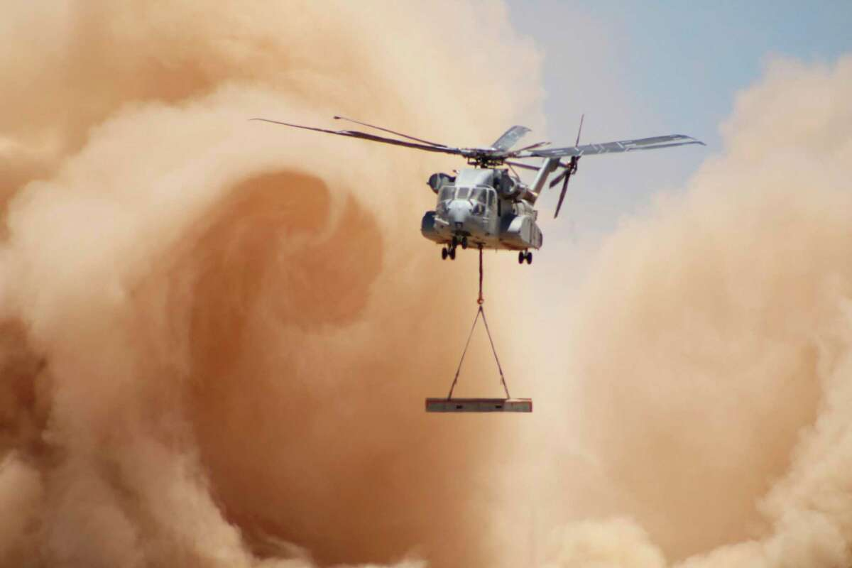 A Sikorsky CH-53K King Stallion helicopter kicks up dust in July testing at the U.S. Army's Yuma Proving Ground in Arizona. The Israeli Air Force has flagged the helicopter's engines, made by GE Aviation, for their ability to withstand sand and dust without degradation.