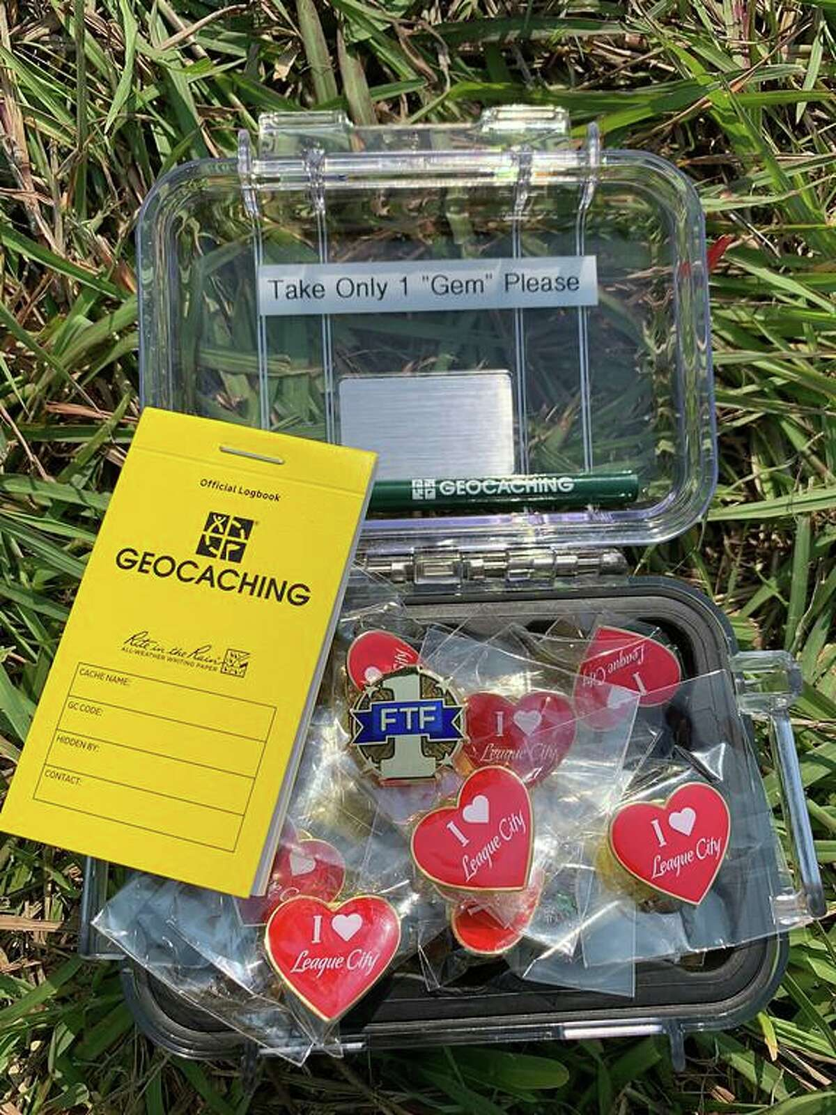 """As part of League City's Geotour, participants use an app to find hidden """"caches"""" with prizes ."""