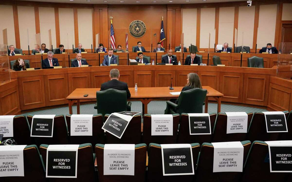 Bill Magness, President and CEO of the Electric Reliability Council of Texas (ERCOT), right at table, testifies as the Committees on State Affairs and Energy Resources hold a joint public hearing to consider the factors that led to statewide electrical blackouts, Thursday, Feb. 25, 2021, in Austin, Texas. The hearings were the first in Texas since a blackout that was one of the worst in U.S. history, leaving more than 4 million customers without power and heat in subfreezing temperatures. (AP Photo/Eric Gay)