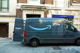 An Amazon delivery van, with the driver nowhere in sight.