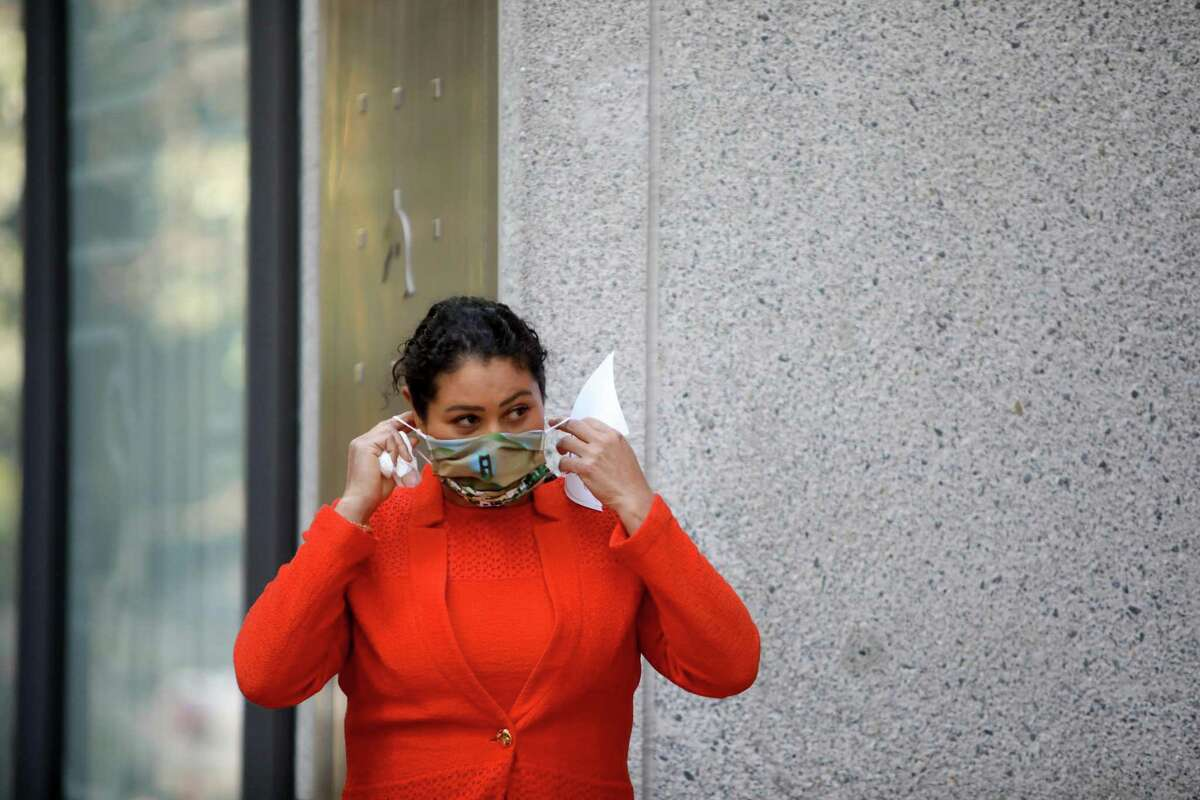 San Francisco Mayor London Breed dons her mask after speaking during a press conference in front of Rincon Center in San. Francisco, Calif. A group advocating for Black city employees issued a scathing response to San Francisco's order that its workers be vaccinated against the coronavirus, calling the mandate harsh and insensitive and threatening legal action on grounds that Black people could be disciplined more often than others.