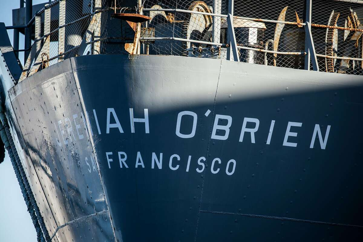 The SS Jeremiah O'Brien is seen on Pier 35 as it is being prepared to be towed by tug boats back to its berth at Pier 45 following the May 2020 four-alarm fire that destroyed an adjacent warehouse on the pier in San Francisco, California Tuesday, Mar. 23, 2021