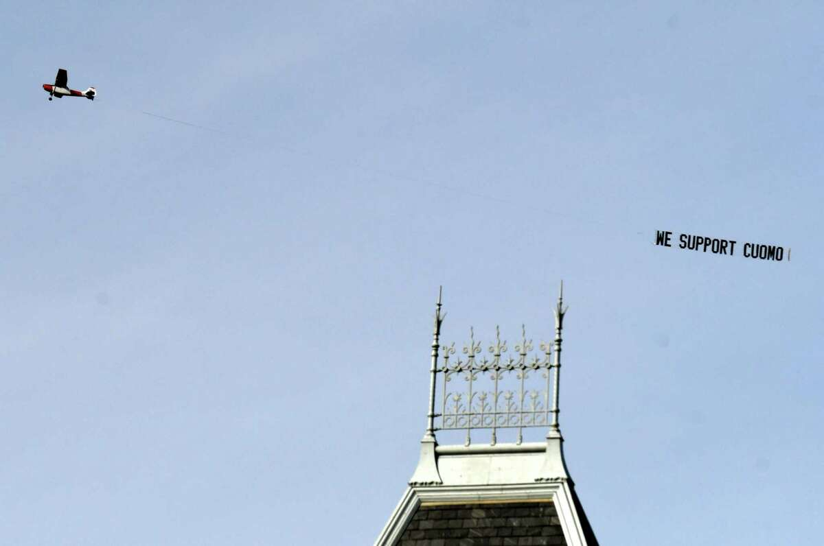 A airplane flies over Albany carrying a banner supporting Gove. Andrew Cuomo on Tuesday, March 23, 2021, in Albany, N.Y. (Will Waldron/Times Union)