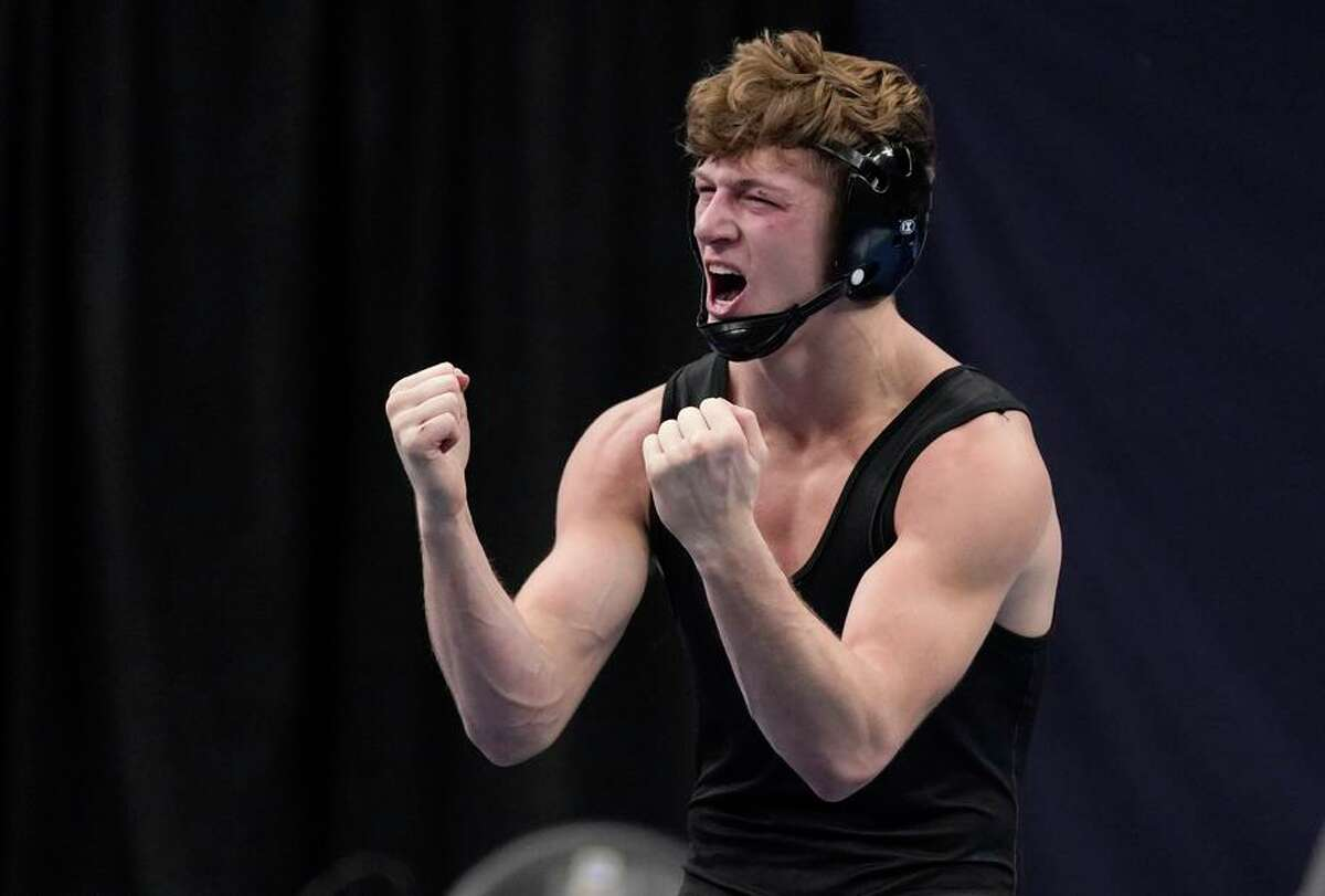 Stanford's Shane Griffith celebrates after defeating Pittsburgh's Jake Wentzel during their 165-pound match in the finals of the NCAA wrestling championships Saturday, March 20, 2021, in St. Louis. (AP Photo/Jeff Roberson)