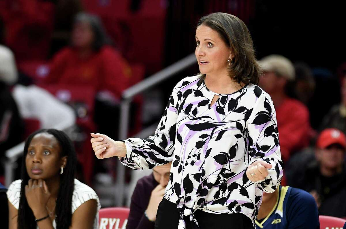 Coach Jennifer Rizzotti of the George Washington Colonials watches the game against the Maryland Terrapins at Xfinity Center on Nov. 20, 2019 in College Park, Md.