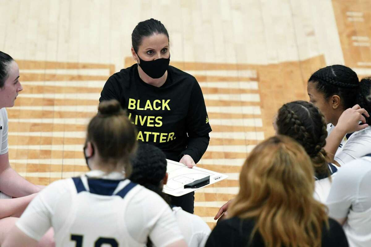 Coach Jennifer Rizzotti of the George Washington Colonials talks to her players during a timeout of a women's college basketball game against the George Mason Patriots at The Smith Center on Feb. 28 in Washington.