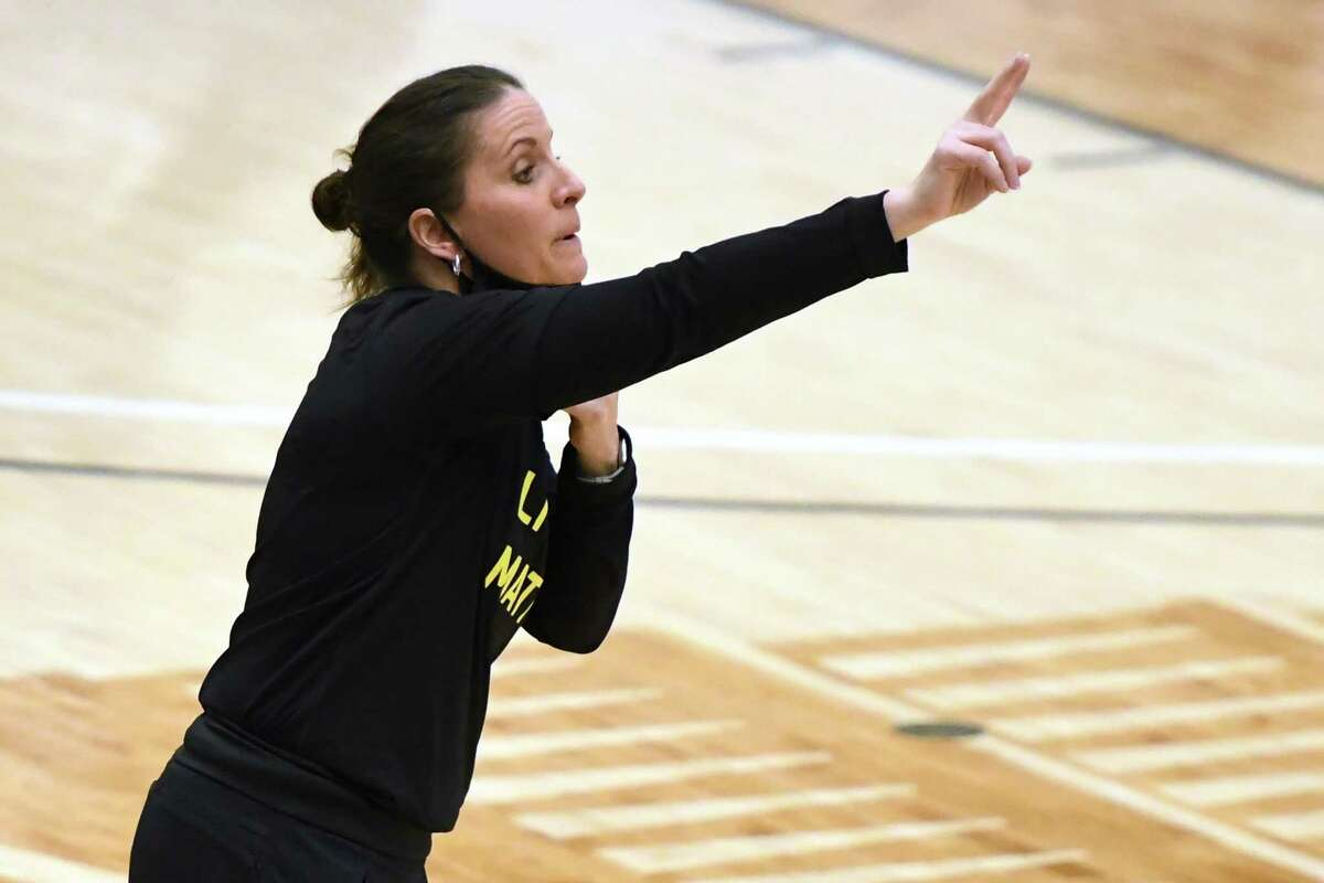 Coach Jennifer Rizzotti of the George Washington Colonials signals to her players during a women's college basketball game against the George Mason Patriots at The Smith Center on Feb. 28 in Washington.