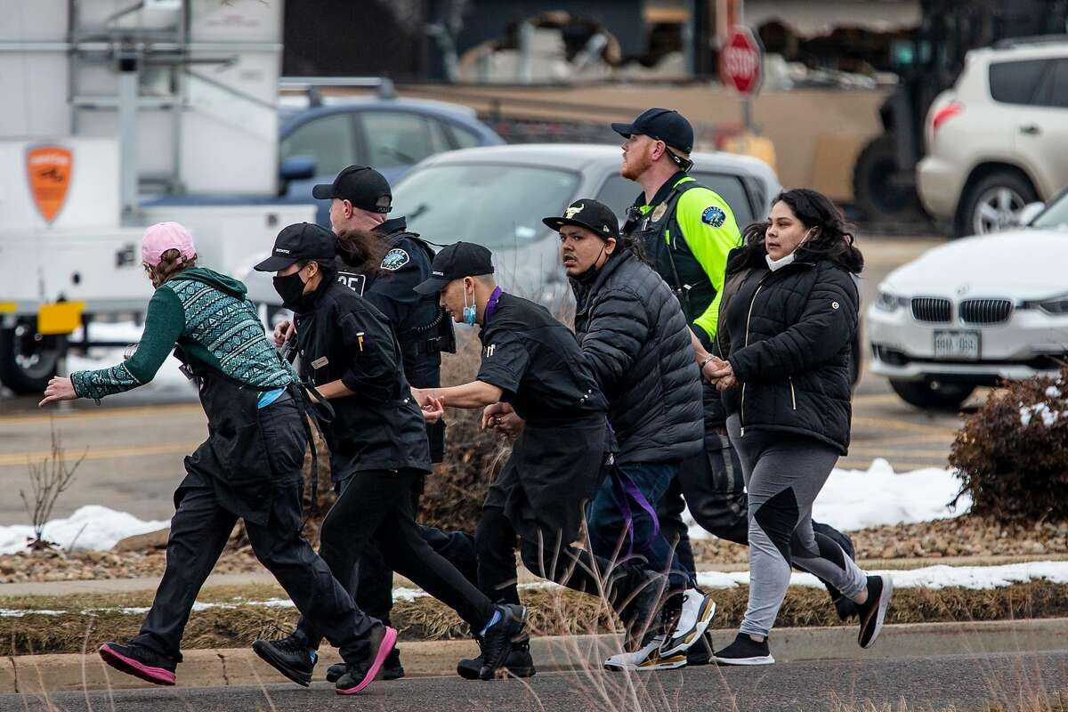 Shoppers were evacuated after a gunman opened fire at a supermarket in Boulder, Colo., on Monday.