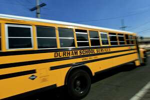 Norwalk school buses, Tuesday, March 23, 2021, in Norwalk, Conn. Norwalk schools are swapping out hybrid learning with full in-person for middle and high schoolers but many parents question how the change will work.